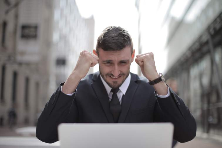 man happy after success from blog writing services